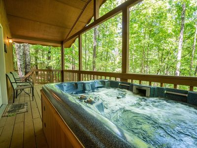 Photo for Enjoy the wood burning fireplace, Sit in the hot tub from a totally private back deck. This lovely c