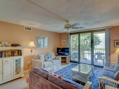 Photo for Bright condo w/ full kitchen, shared pools, hot tub, beach access & more!