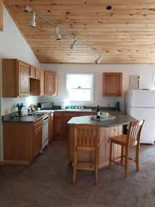 Fully stocked open concept kitchen with breakfast bar island
