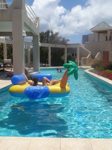 Relax on a float while other guests enjoy playing in the shallow end