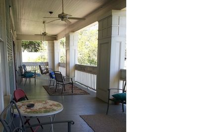 Huge covered porches with tables, chairs and swings.