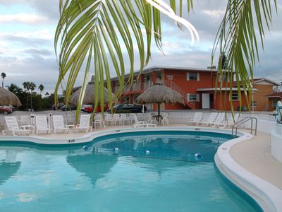 The condos and our sparkling pool with tiki huts and lots of chairs for relaxing & sun bathing.