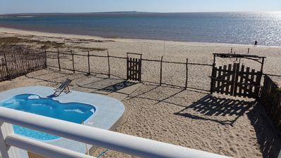 Photo for Villa 4 feet in the water with private pool on a deserted beach