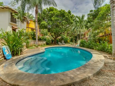Photo for NEW LISTING! Comfortable condo w/shared pool - walk to beach