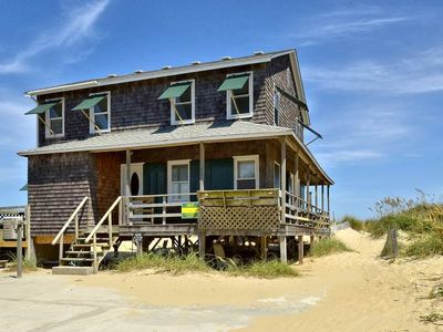 Photo for Wonderful oceanfront cottage in the heart of Nags Head! Old school charm, modern amenities! Awesome oceanfront dune-deck! Short walk to popular dining and shopping options.