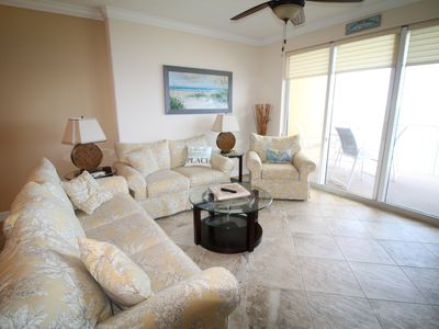 Photo for Spectacular beachfront condo! Beach chairs included! Affordable rates!