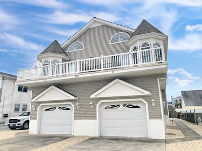 Photo for JUST A FEW BLOCKS from the beach, and has views of the bay fro the deck.