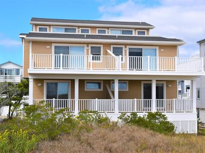 Photo for BEACH BLOCK TOWNHOUSE WITH OFFSTREET PARKING, DECK, GRILL, A/C, AND MORE!