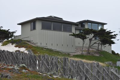 View of the house from Sunset Drive located right along the beach & ocean