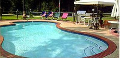 Photo for Family  time fishing, swimming, boating, grilling & relaxing in rockers on porch