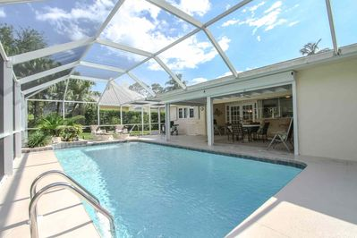 Tropical heated outdoor pool area provides an abundance of entertaining space for guests, as well as BBQ (propane/gas) grill for outdoor cooking.