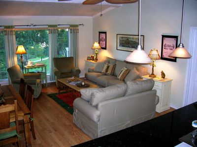 Great room features vaulted planked & beamed ceilings and pergo flooring