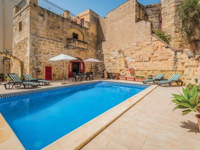 Photo for Renovated Villa w/pool, BBQ, and a pretty courtyard, close to amenities