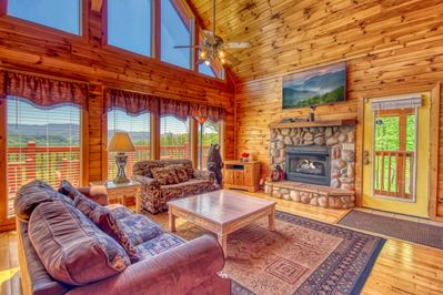 Unbelievable views - Great room with BIG Screen TV. Amazing ambience with fireplace & views from living room