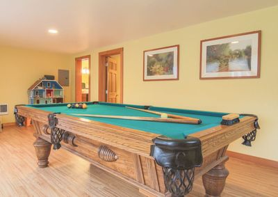 Managed by Bloomer Estates Vacation Rentals.   People love our extra large 8 foot slate pool table with ping pong table top in the recreation room.