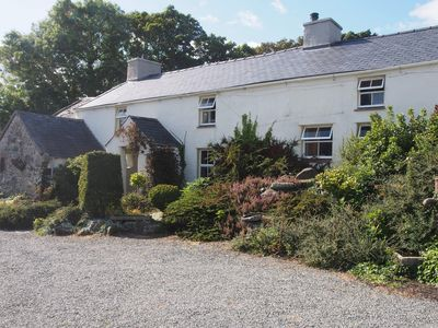 Photo for Nestling in a quiet corner of Anglesey - beautiful traditional Welsh cottage.