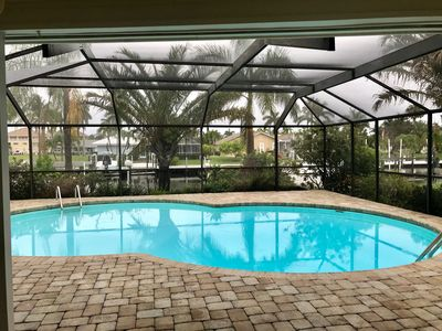 Photo for Remodeled- NEW air conditioner, 3 bed, 2 bath, heated pool, dock, lift, privacy