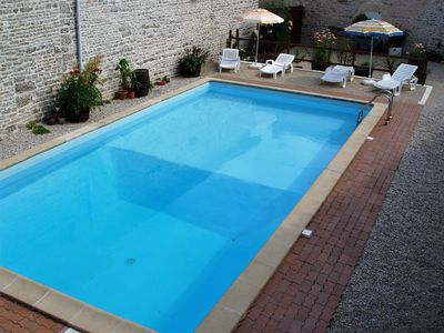 Photo for 2 Bedroom cottage with swimming pool set in a walled courtyard