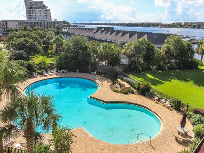 Photo for Beautiful bayfront condo with pool access, beach, and a nearby dock!