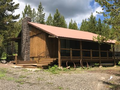 Photo for Porch lined cabin nestled in the Pines for lazy summer days