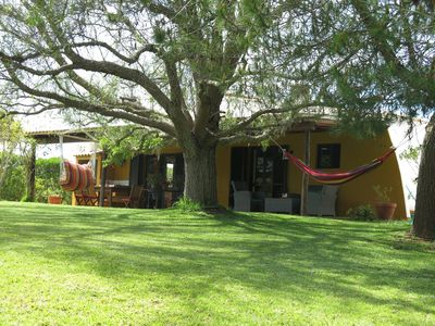 A lovely shady pepper tree to laze in the hammock and hanging chair!