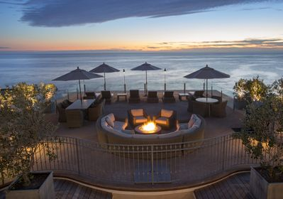 Common Area Deck with Firepit - Enjoy an Evening Around a Warm Fire Watching the Sun Set Over the Blue Pacific