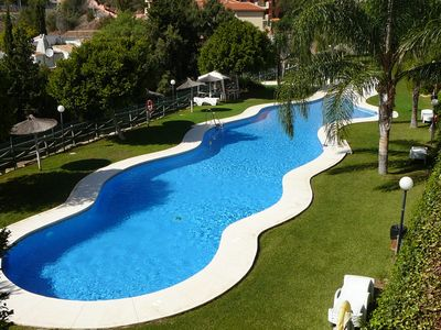 Photo for Modern apartment, fantastic view, 2 bedrooms, pool, baby pool, fiber network BBQ