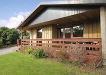 Photo for Four star Lodge with two bedrooms and bathrooms, fabulous views yet close to pubs and beach
