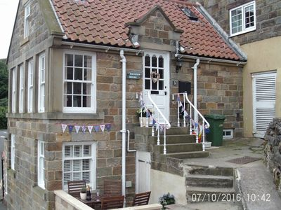 Galleon House with its summer bunting!