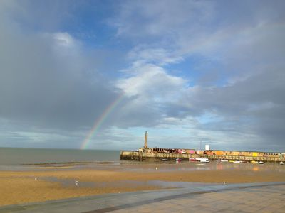 View towards Margate Harbour Arm and lighthouse, with Artists' studios and cafes