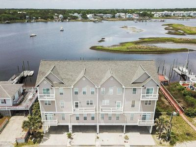 Photo for docks, decks & sunsets -Immaculate 4 bedroom, 3 Bath waterfront condo and private 55' deep water ...