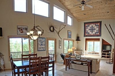 Very high vaulted ceilings in the main living and dining area