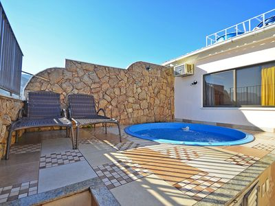 Photo for Lovely penthouse with pool and view, 2 minutes from the beach!