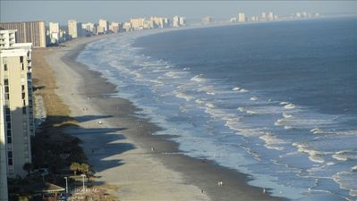 Looking down on the tranquil sands of Myrtle Beach from your wrap-around balcony