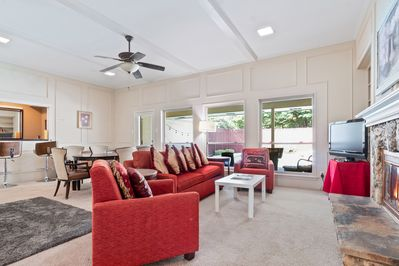 Large Living Area overlooking Pool and covered patio