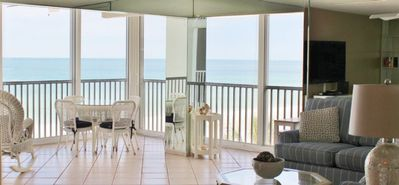 Photo for Condo directly on the #1 beach! Sunset views! Pool! Beach Loungers! Free Wifi