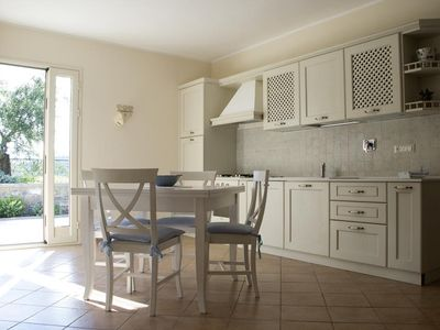 Photo for charming apartment in a villa, 1.5 km from the sea with parking in town