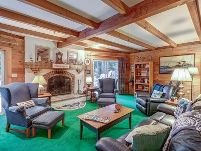 Photo for NEW LISTING! Lakefront house with private beach and dock, multiple decks