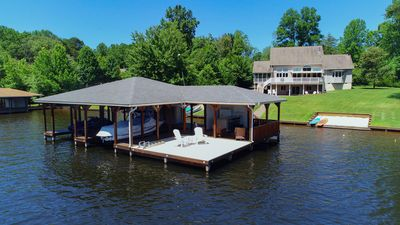 Photo for Luxury LAKEFRONT home- covered dock/outdoor living in quiet cove. Fun 4 all ages