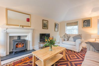 The sitting room has a cosy gas stove