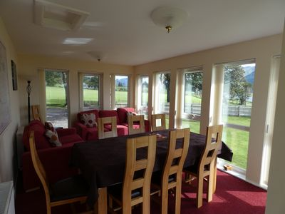 Stunning conservatory with Solid oak dining table and Chairs, plus comfy seating
