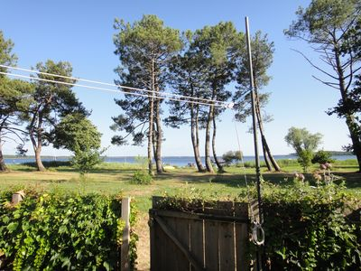Photo for Beautiful wooden house on the edge of the Moutchic lake EXCEPTIONAL VIEW - direct access
