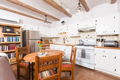 Fully equipped kitchen with seating for 4.