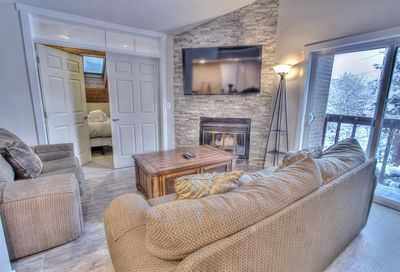 """Living Room with 60"""" HD Smart TV, Fireplace, Private Deck and Queen Sofa Sleeper"""
