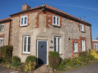 Photo for A wonderfully quirky brick and flint newly refurbished cottage