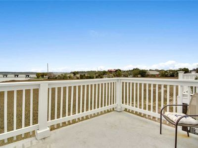 Photo for Spectacular marsh and river views with a seasonal community pool.
