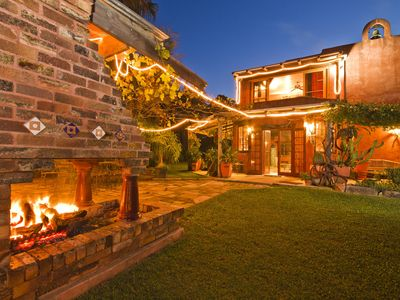 Photo for Luxury with inside and outside fireplaces and heated pool and pet friendly.