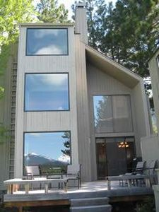 This beautiful three story condo has gorgeous mountain and lake views.