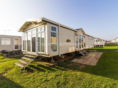 Photo for California Cliffs Norfolk 2 bed 6 berth mobile home with CH & DG. pets ok!