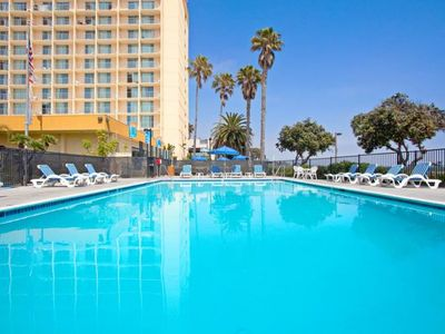 Photo for Ventura Beach Vacay Starts Here! Elegant Unit for 4, Pool, Direct Beach Access